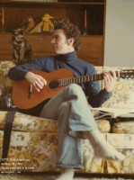 John and cat with guitar